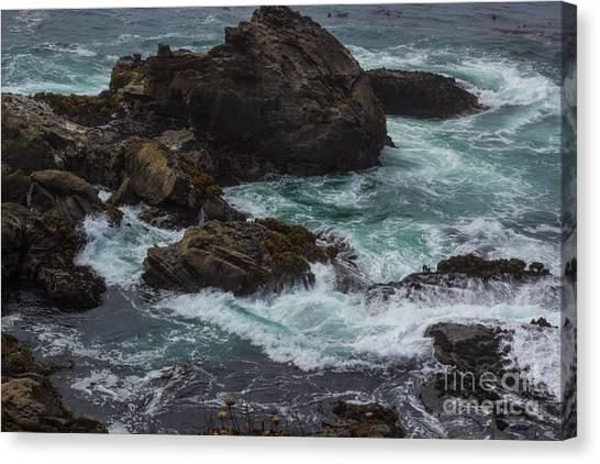 Waves Meet Rock Canvas Print