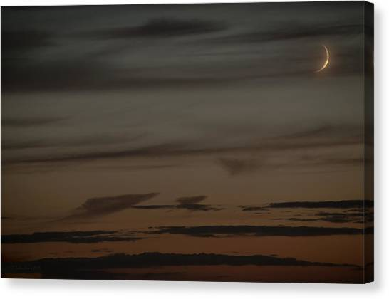 Waxing Crescent Moon Over Purple And Orange Evening Sky Canvas Print