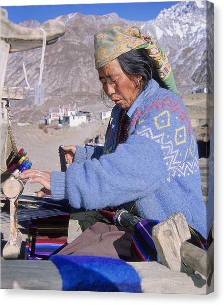 Weaving Scarves In Muktinath Canvas Print by Richard Berry