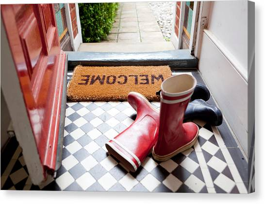 Welcome Mat And Wellington Boots Canvas Print by Image Source