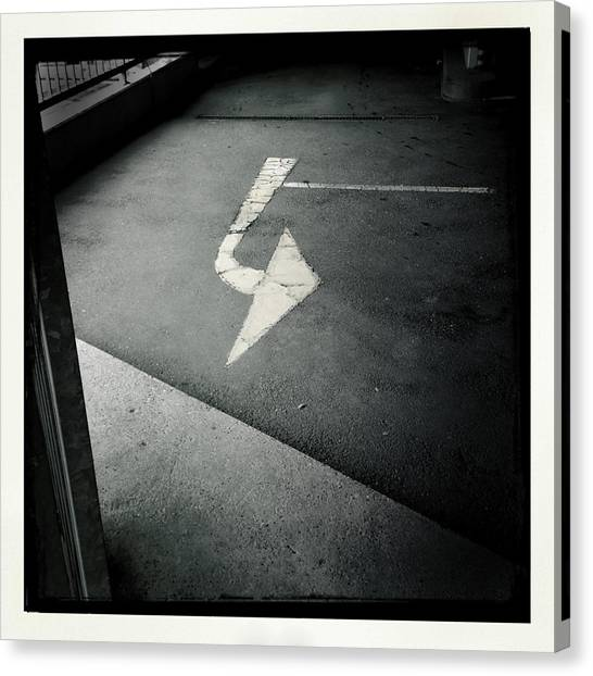 White Canvas Print - White Arrow On Dark Asphalt by Matthias Hauser