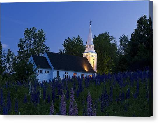 White Church At Dusk In A Field Of Lupines Canvas Print