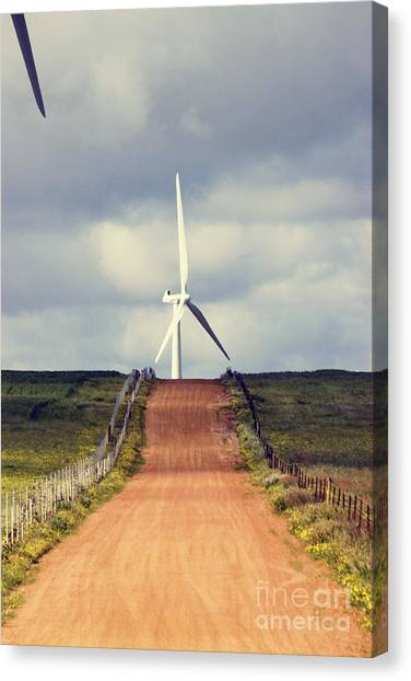 Clean Energy Canvas Print - Wind Turbine And Red Dirt Road by Colin and Linda McKie