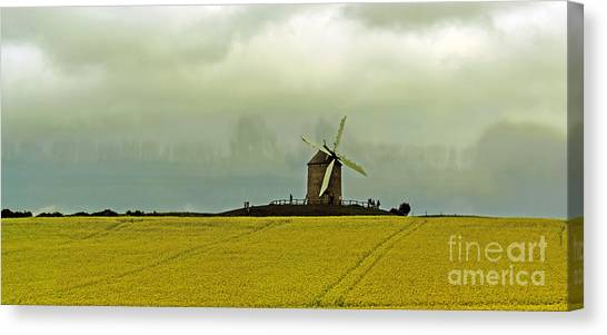 Windmill And Rapeseed And Storm Canvas Print