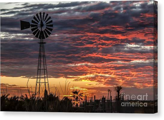 Desert Sunrises Canvas Print - Windmill And The Sunset by Robert Bales