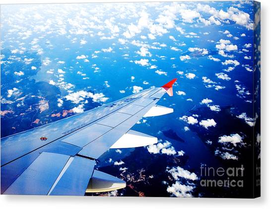 Canvas Print featuring the photograph Wings And Clouds by Yew Kwang