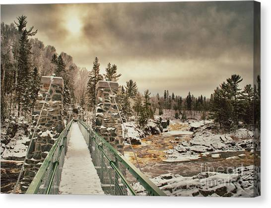 Winter Sunrise Over A Swinging Bridge Canvas Print