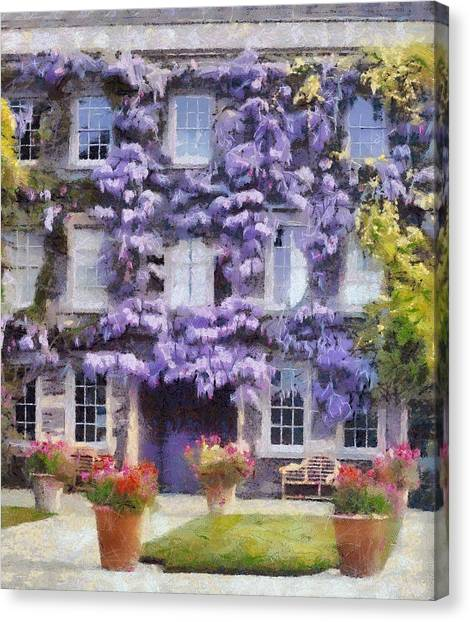 Wisteria Covered House Canvas Print by Desmond De Jager
