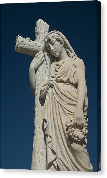 Woman And Cross Statue Canvas Print