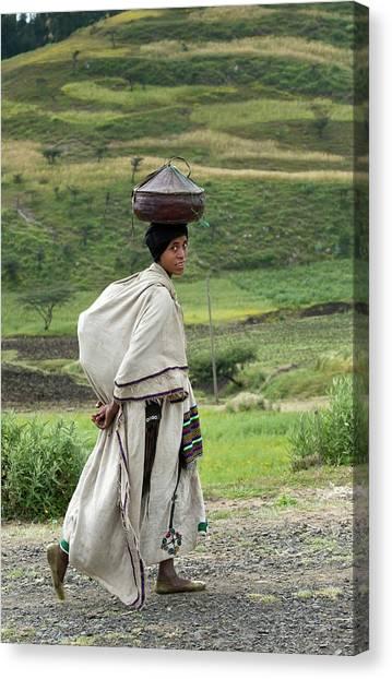Ethiopian Woman Canvas Print - Woman Balancing Lunchbox On Her Head by Tony Camacho