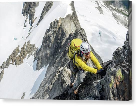 Backpacks Canvas Print - Woman Climbing On The North Ridge by Alasdair Turner