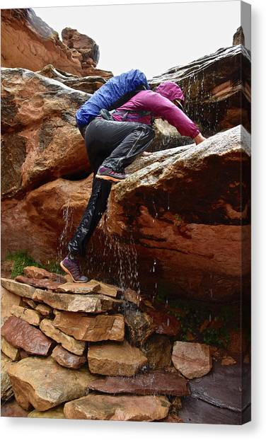 Backpacks Canvas Print - Woman Climbing Up A Waterfall by HagePhoto