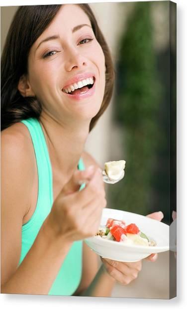 Salad Canvas Print - Woman Eating Fruit Salad by Ian Hooton/science Photo Library