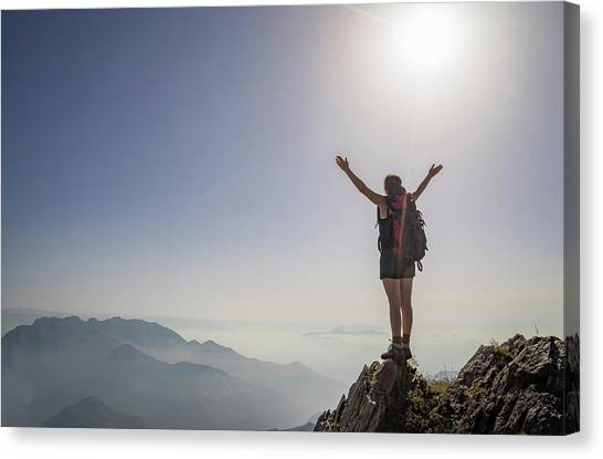 Woman Exulting On A Mountaintop Canvas Print by Buena Vista Images