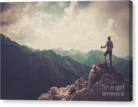 Cliffs Canvas Print - Woman Hiker On A Top Of A Mountain by Nejron Photo