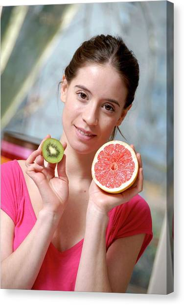 Kiwis Canvas Print - Woman Holding Fruit by Aj Photo/science Photo Library