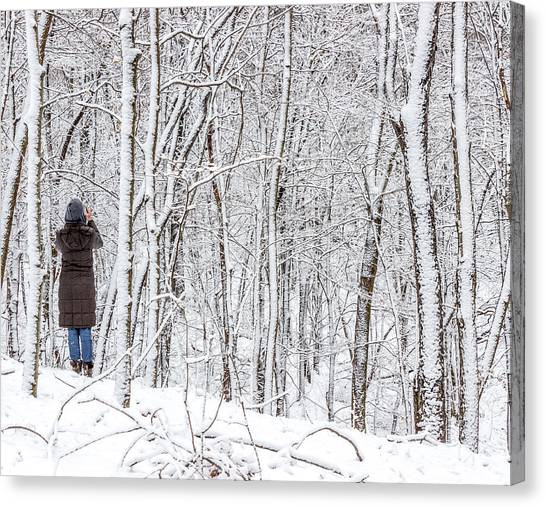 Woman In A Snow Covered Forest Canvas Print