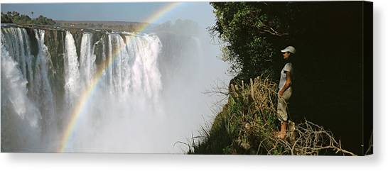 Victoria Falls Canvas Print - Woman Looking At A Rainbow by Panoramic Images