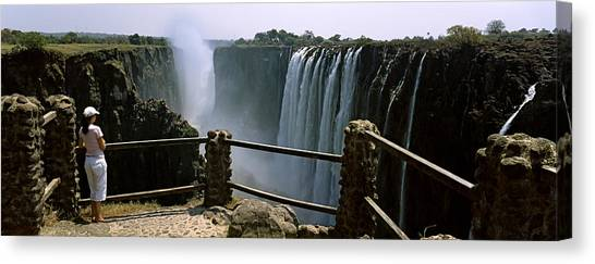 Victoria Falls Canvas Print - Woman Looking At The Victoria Falls by Panoramic Images