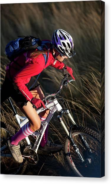 Backpacks Canvas Print - Woman Mountain Biking by Woods Wheatcroft