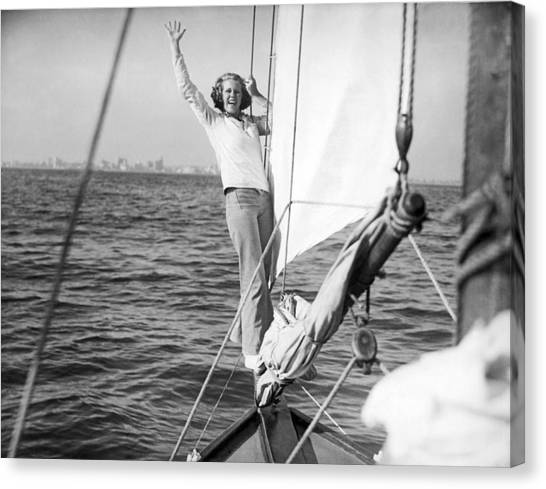 Jibbing Canvas Print - Woman On Bow Sprit Of Sailboat by Underwood Archives