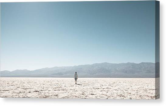 Woman On Field Against Clear Sky Canvas Print by Christian Soldatke / EyeEm
