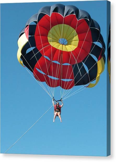 Woman Parasailing Canvas Print by Rob Huntley