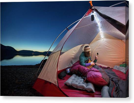 Ukuleles Canvas Print - Woman Playing Ukulele In Her Tent by Woods Wheatcroft