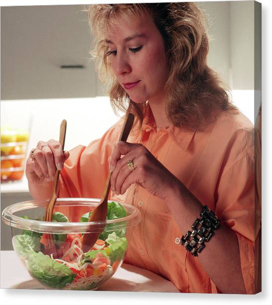 Salad Canvas Print - Woman Prepares A Green Salad by Cc Studio/science Photo Library