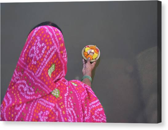 Ganges Canvas Print - Woman Putting Flower Lamp Onto by Keren Su