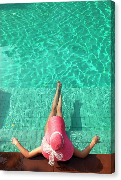 Woman Resting At Edge Of Swimming Pool Canvas Print