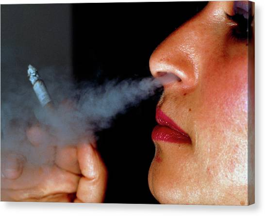 Woman Smoking A Cigarette Canvas Print by Harvey Pincis/science Photo Library