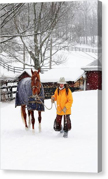 71cb9e41c0 Warm Front Canvas Print - Woman Standing With Her Horse In Snowy by Beck  Photography