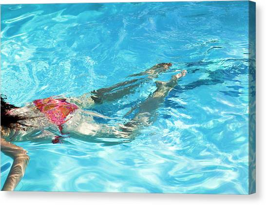 Woman Swimming Canvas Print by Gustoimages/science Photo Library