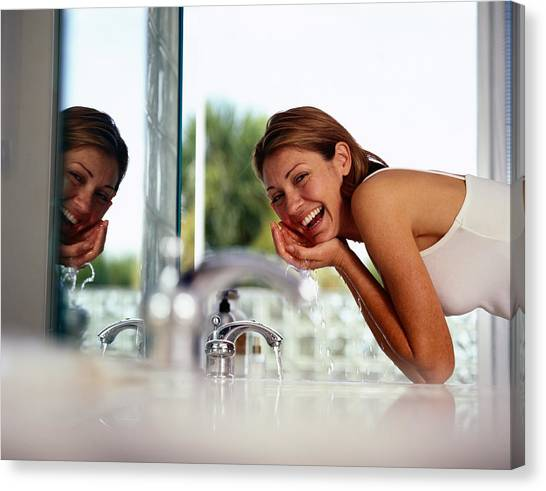 Woman Washing Her Face Canvas Print by Hoby Finn