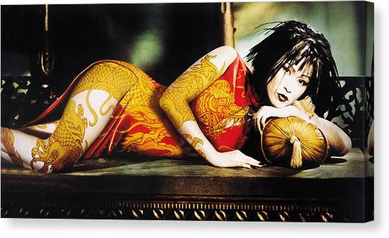 Woman With Arm And Leg Painted Lying On Sofa Canvas Print by Eryk Fitkau