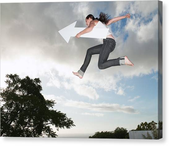 Woman With Blank Arrow Leaping Outdoors Canvas Print by Robert Daly