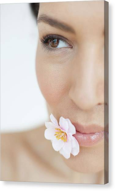 Woman With Flower Canvas Print by Ian Hooton/science Photo Library