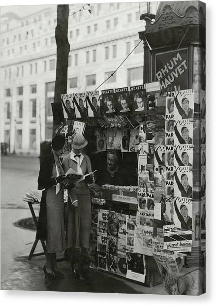 Women At A Newsstand In Paris Canvas Print