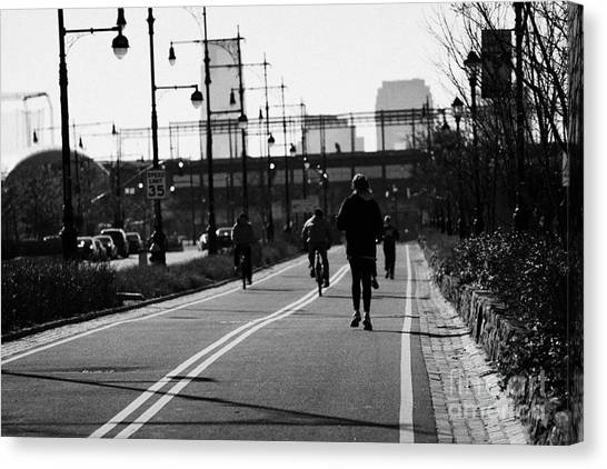 Joe Dimaggio Canvas Print - women running and men cycling exercising on bikeway next to West Side Highway new york by Joe Fox