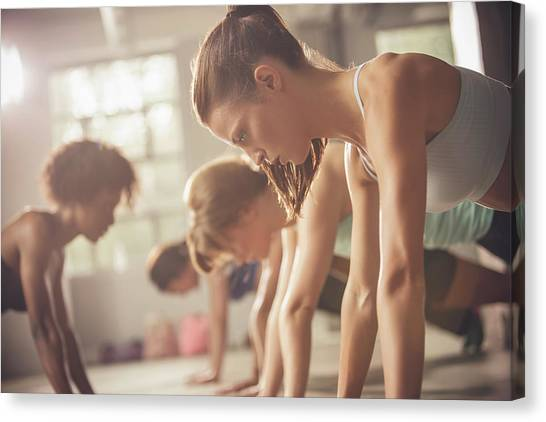 Women Working Out In Exercise Class Canvas Print by John Fedele