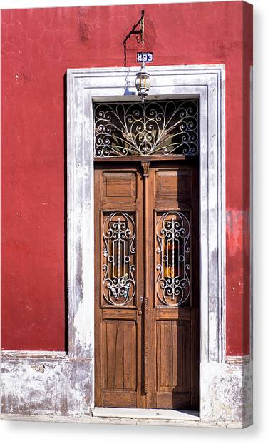 Canvas Print featuring the photograph Wood And Wrought Iron Doorway In Merida by Mark E Tisdale