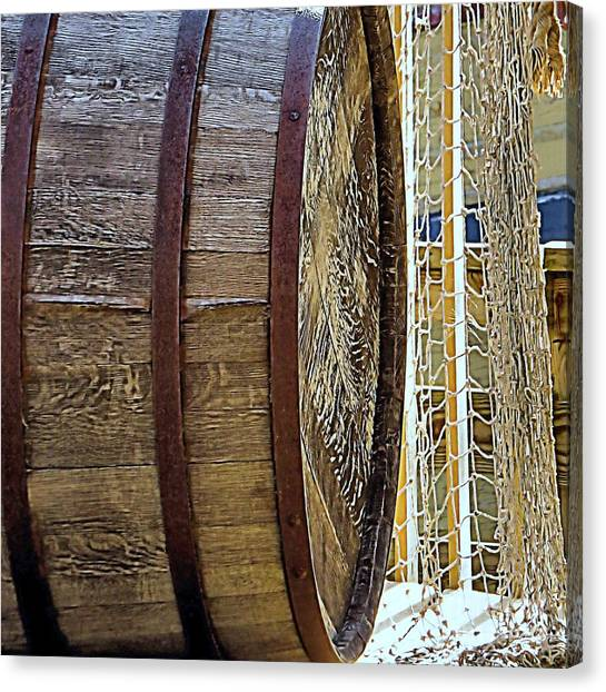 Wooden Barrel And Net Canvas Print by Janice Drew