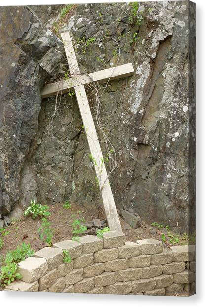 Wooden Cross In The Rocks Canvas Print by Jennifer Cairns