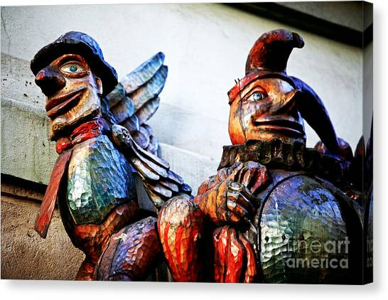 Wooden Statues Canvas Print by John Rizzuto