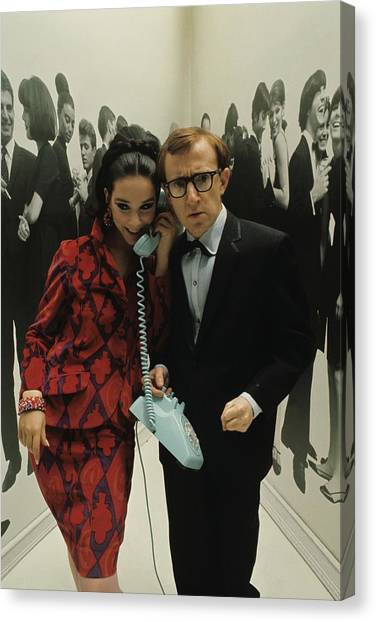 Woody Allen Posing With A Model Holding Canvas Print by David Mccabe