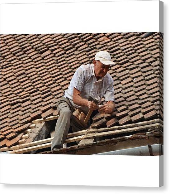 Repairs Canvas Print - Worker On A Roof Repairing Tiles In by Adriano La Naia