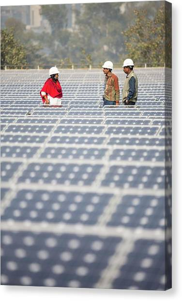 Mega Man Canvas Print - Workers At A 1 Mw Solar Power Station by Ashley Cooper