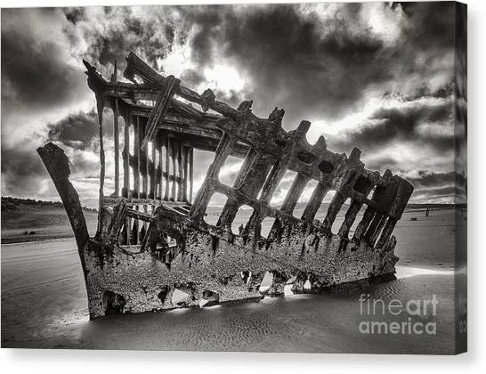 Wreck On The Shore Canvas Print by Melody Watson