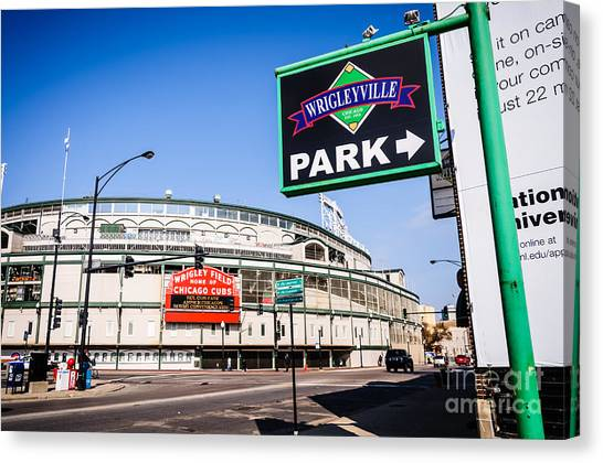 Chicago Cubs Canvas Print - Wrigleyville Sign And Wrigley Field In Chicago by Paul Velgos